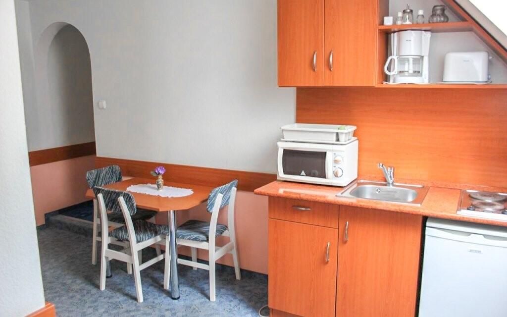 Při ubytování v apartmánech je k dispozici i kuchyňka