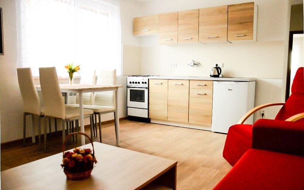 Ve větších apartmánech si uvaříte v plnohodnotné kuchyni