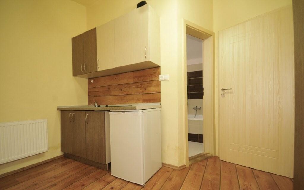 V apartmánech najdete i kuchyňku