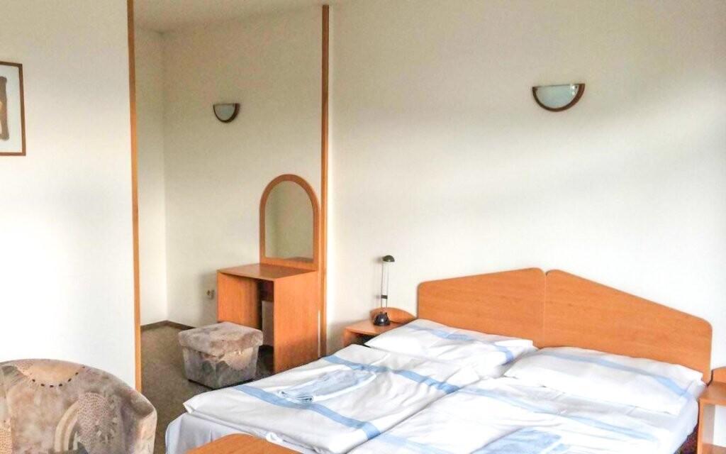 Útulné pokoje s televizí a vlastní koupelnou