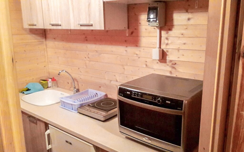 V prvním patře najdete vybavenou kuchyni