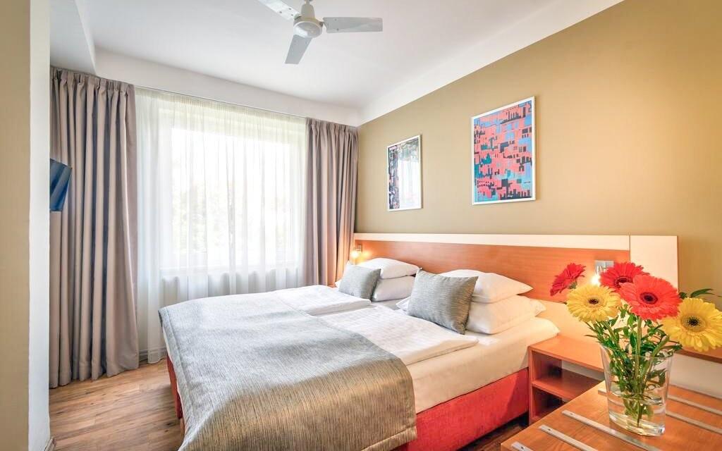 Pokoje jsou laděné do pozitivních barev