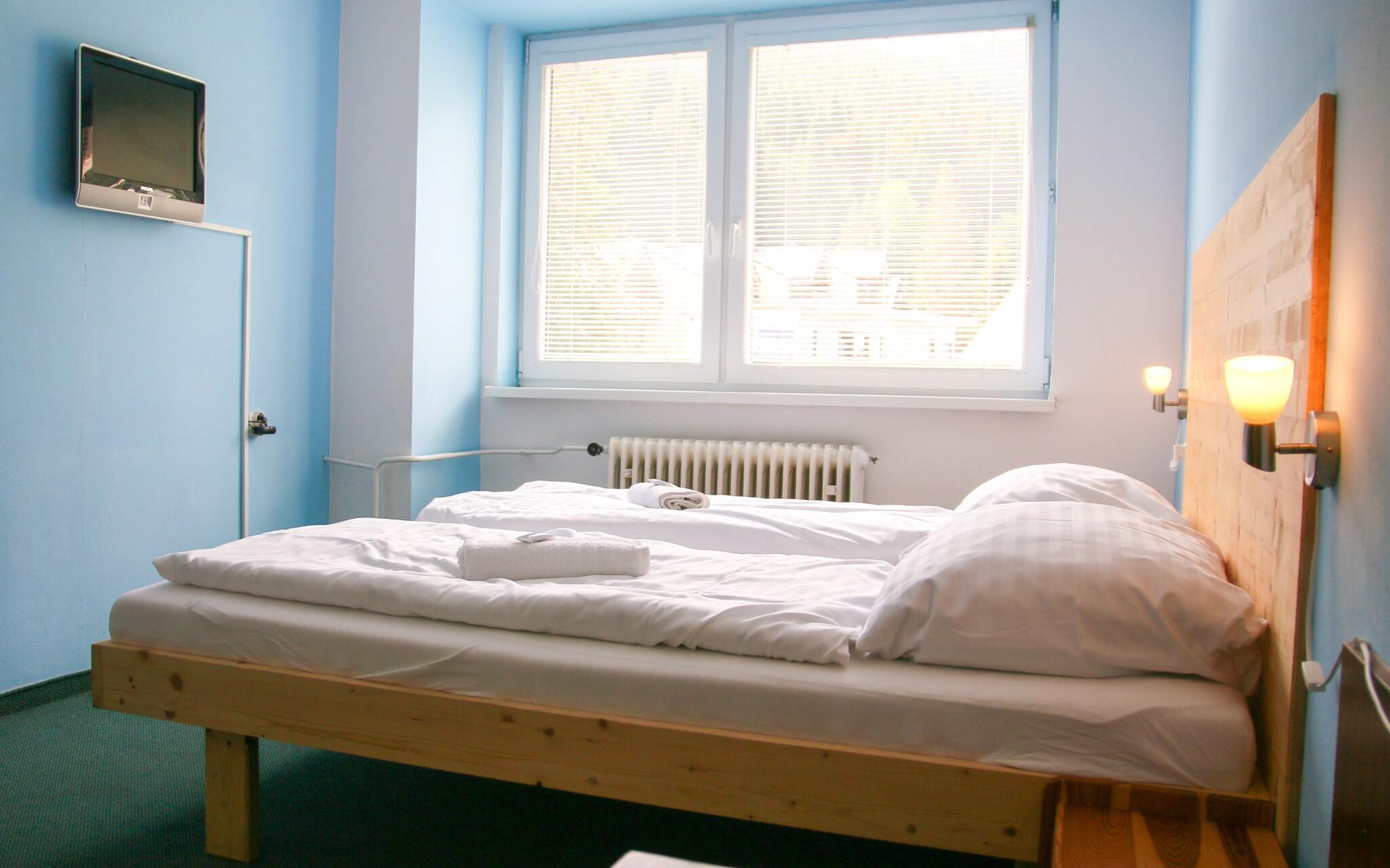 Pohodlné pokoje v Hotelu SKI s výhledem do přírody