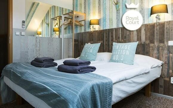 Pokoje hotelu jsou moderně zařízeny a slazeny do tlumených barev